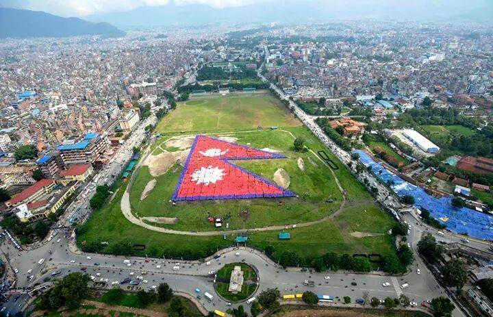 World Record: The Nepalese national flag, formed by 35000+ people at Tudikhel, Kathmandu #Nepal. (by Prakash Mathema) <br>http://pic.twitter.com/6E053Xci39