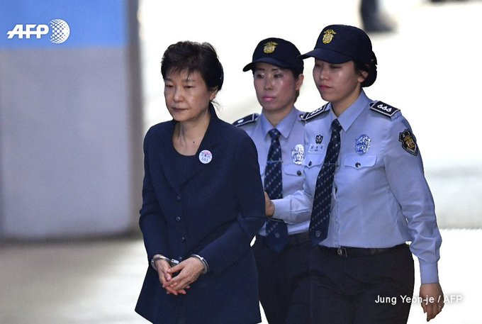 South Korea's former president Park Geun-Hye arrives at Seoul Central District  Court for her trial over a sprawling corruption scandal