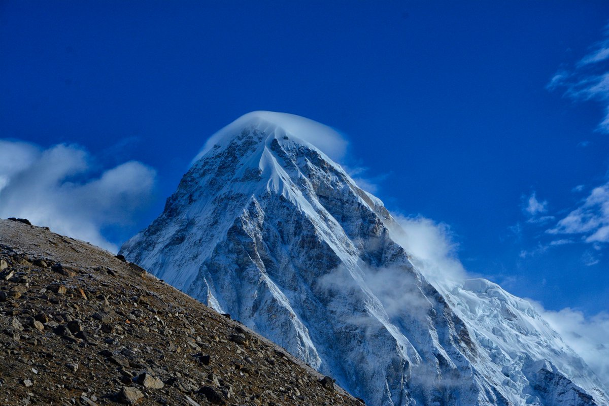 A hat of cloud hovers above Mount Pumori #Nepal #Everest #Pumori #Mountains #Himalayas #VisitNepal #NepalIsAwesome<br>http://pic.twitter.com/WptEs5EgYK
