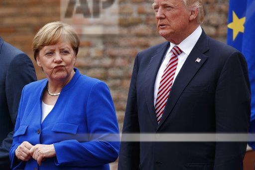 Trump & Merkel at #G7Summit, via @evanvucci https://t.co/6wVcnNYff...