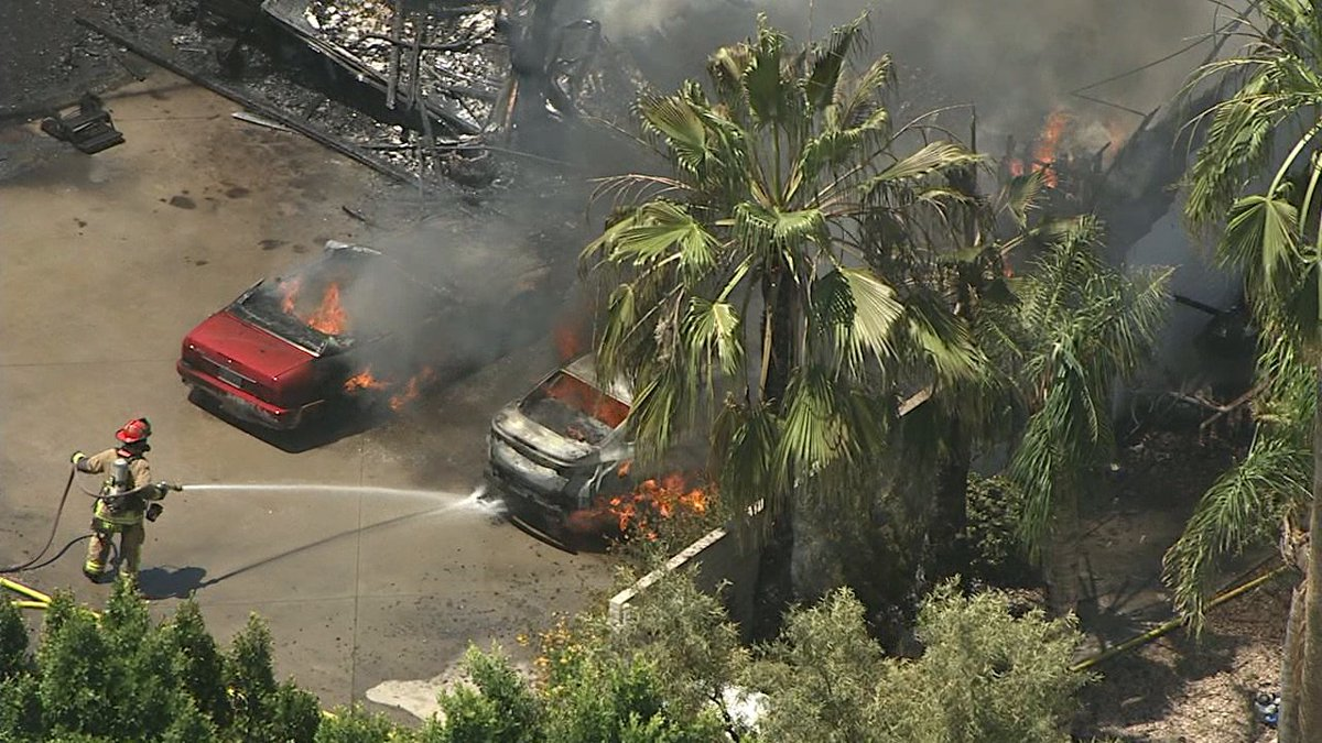PHOTO: Several cars on fire along with the house in #Mesa. https://t.co/YLfa6FxrBu #abc15