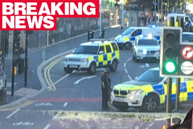 BREAKING: Masked machine-gun armed cops storm BUS in central Mancheste...