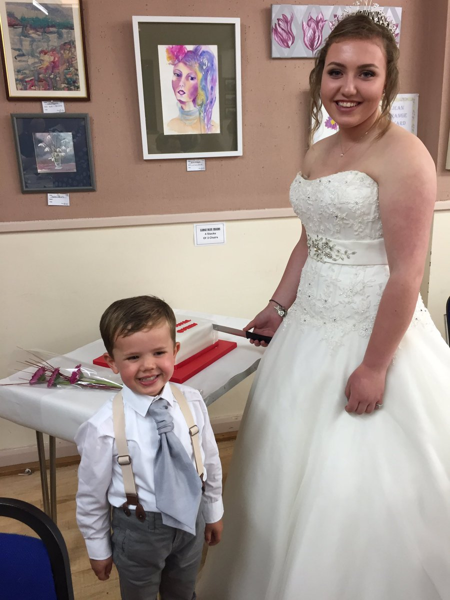 Despite the rain our #festival #queen Lottie is still smiling as she cuts the cake with her lovely pageboy Archie <br>http://pic.twitter.com/bThfpLH44B