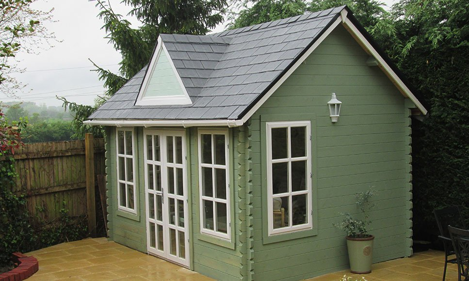A garden &quot;clockhouse&quot; using TapcoSlates and Tapco Ridge Caps situated in Berkshire in the UK. #Roofing #Caps #Slate <br>http://pic.twitter.com/Gl6VAstOoB