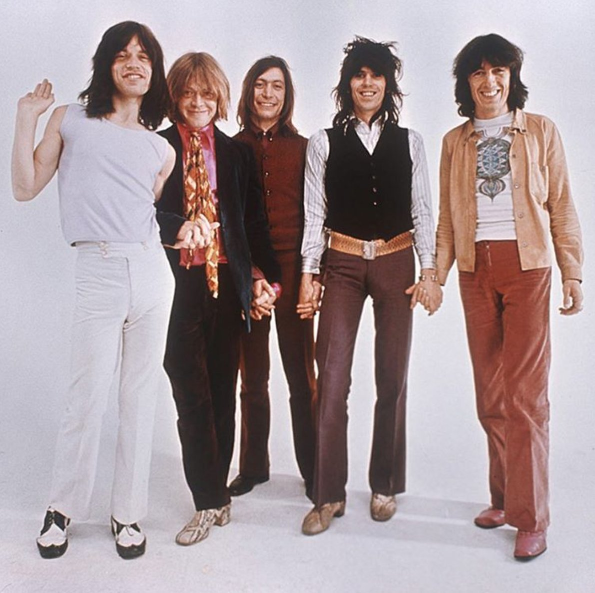 Hold hands and smile! The Stones photographed in 1969 by Ethan Russell...