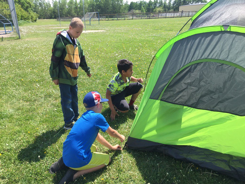 #donsch students setting up tents as they get ready for their yearly camping trip https://t.co/Gmgzqvzx8D