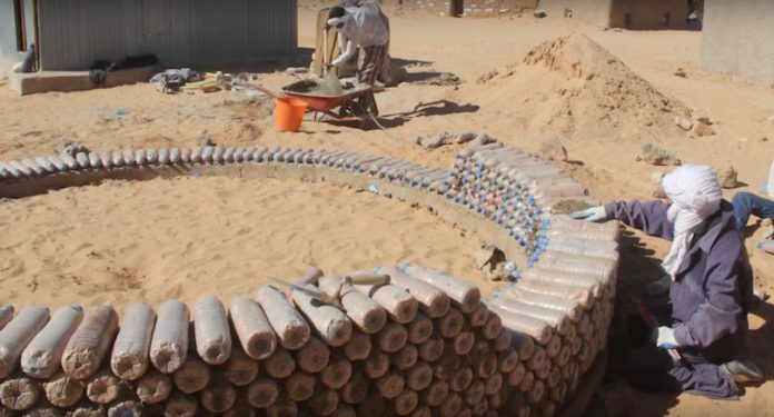A Refugee Engineer Builds Houses Out Of Plastic Bottles In Algeria