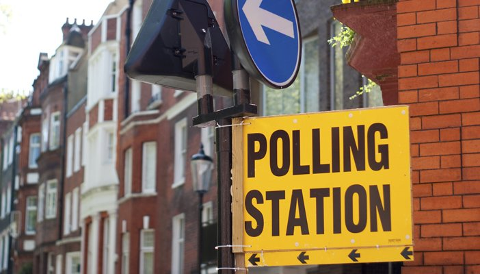 Image shows a street sign which reads 'Polling Station'