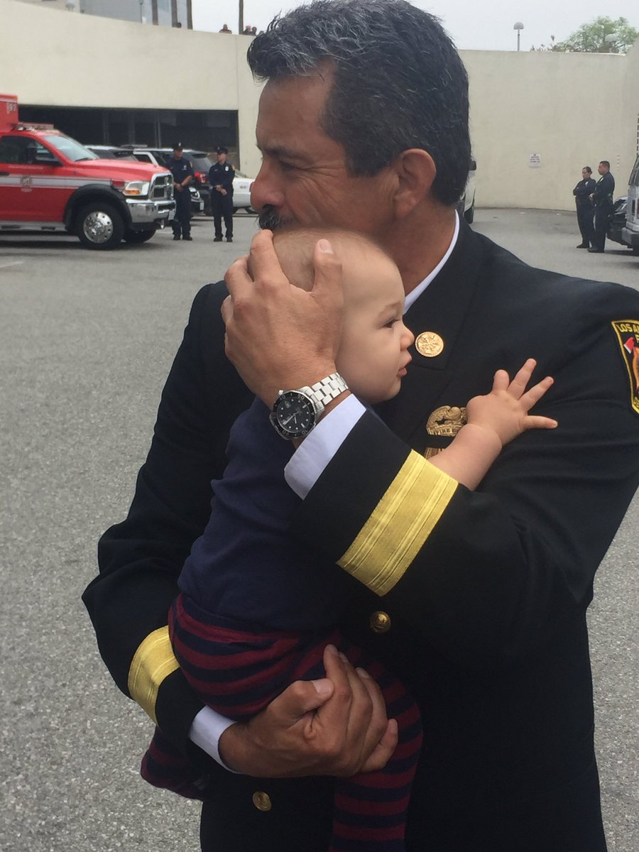#LAFD @LAFDChief Terrazas comforting infant son of our fallen FF #KellyWong while awaiting procession. We are