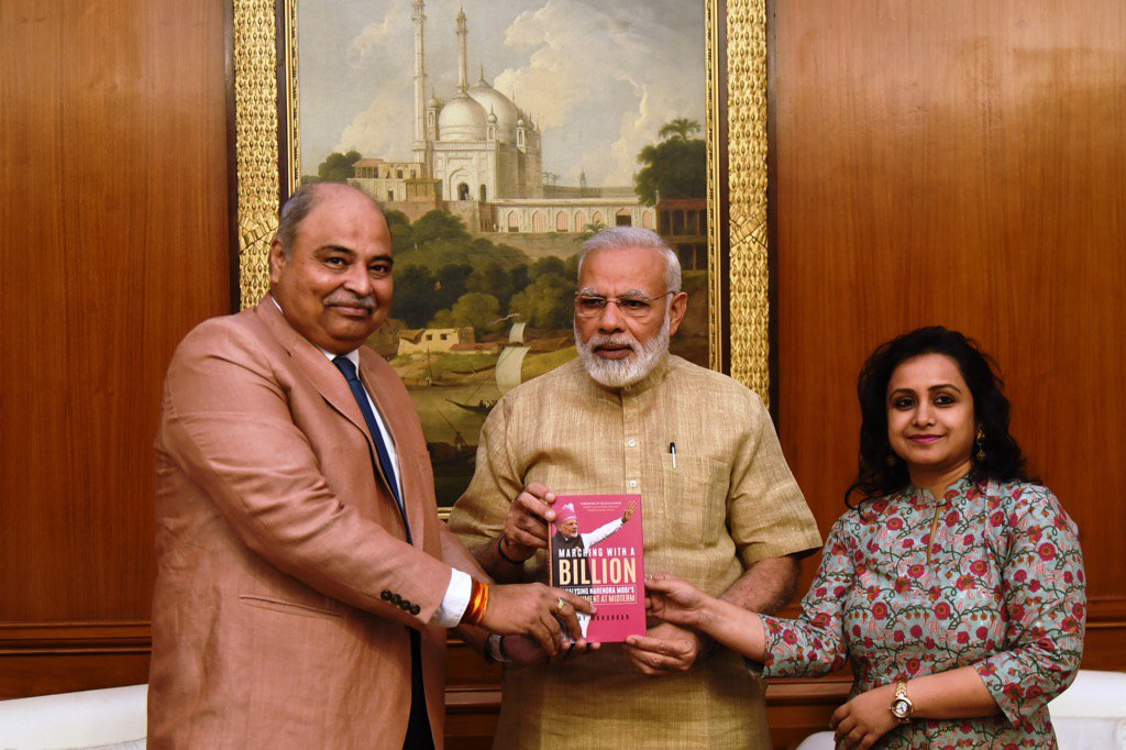Myself n my publisher Milee Ashwarya of Penguin presenting to Prime Minister Modi my new book #MarchingWithABillion