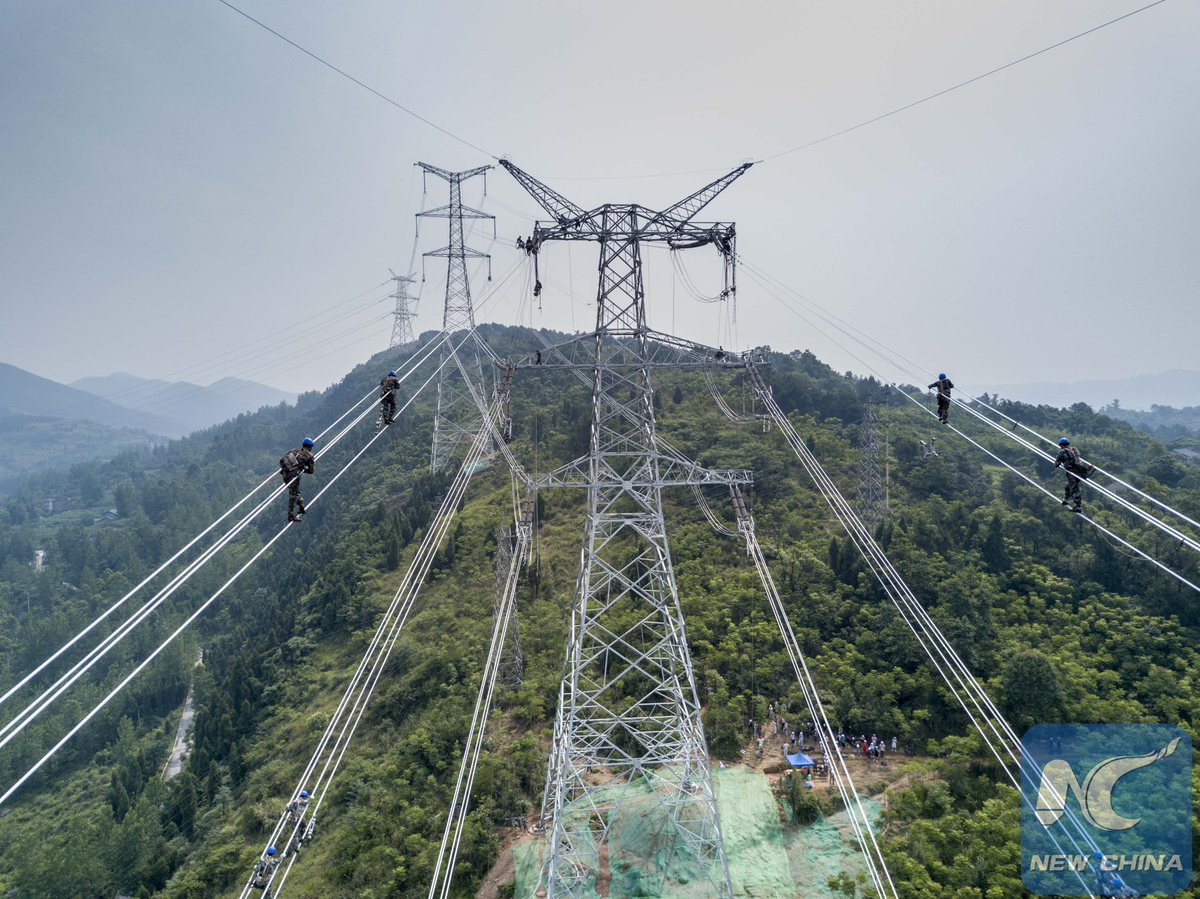 china xinhua news on twitter technicians work on newly built 500 kv power transmission route project over jialing river in sw china s chongqing city like sky walkers https t co oqsoe5zteu 500 kv power transmission route