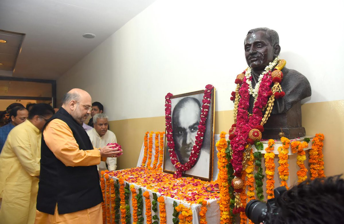BJP National President Shri @AmitShah pays floral tribute to Dr. Syama Prasad Mookerjee on his Martyrdom Day at BJP HQ.