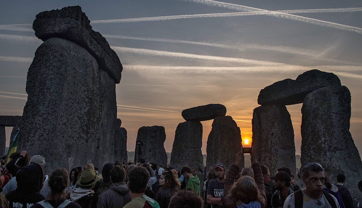 Modern druids and other #SummerSolstice enthusiasts greet the sunrise at Stonehenge in Wiltshire, England on June 21st 2017 (AFP)