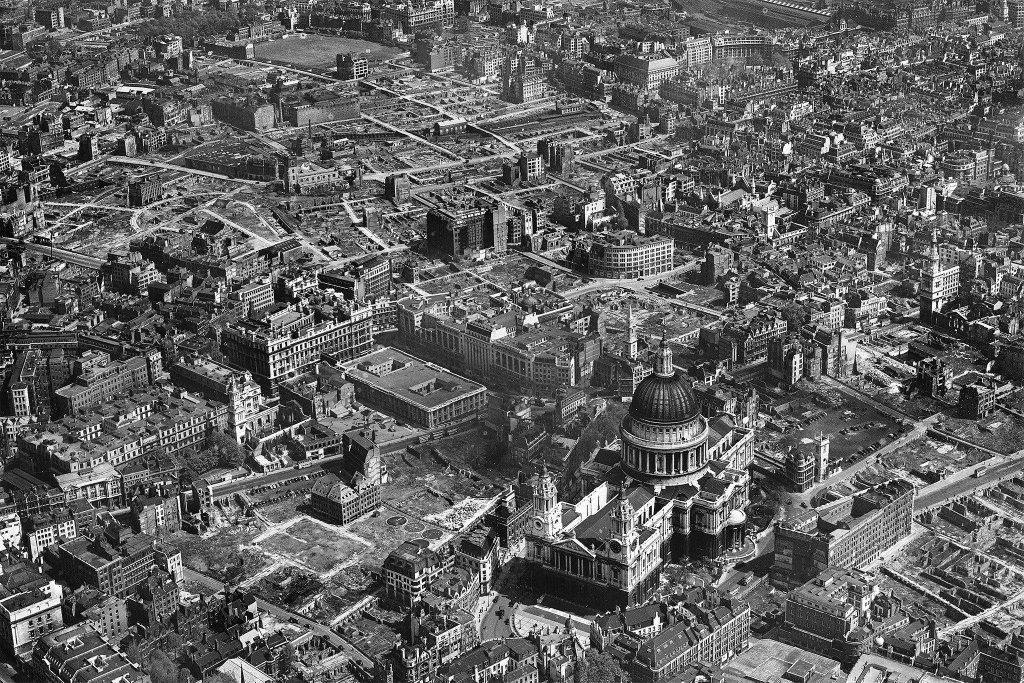 St Paul&#39;s Cathedral #London (photograph by #Aerofilms @HE_Archive ) surrounded by a sea of destruction shortly after the end of 1939-45 WW2<br>http://pic.twitter.com/9rOj0AXfsc