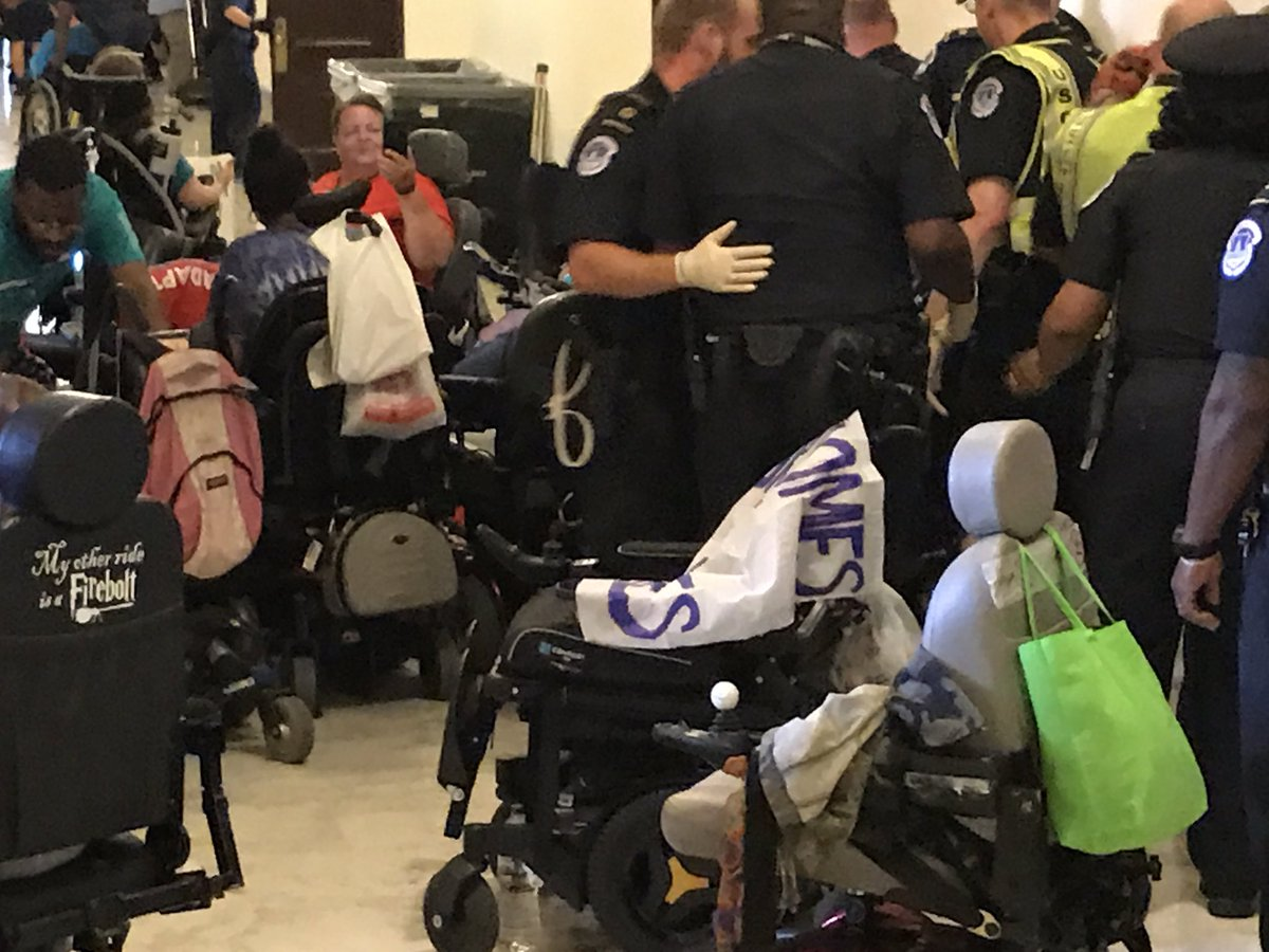 Capitol Police arresting protesters who rely on wheelchairs. They dropped one. #NoCutsNoCaps