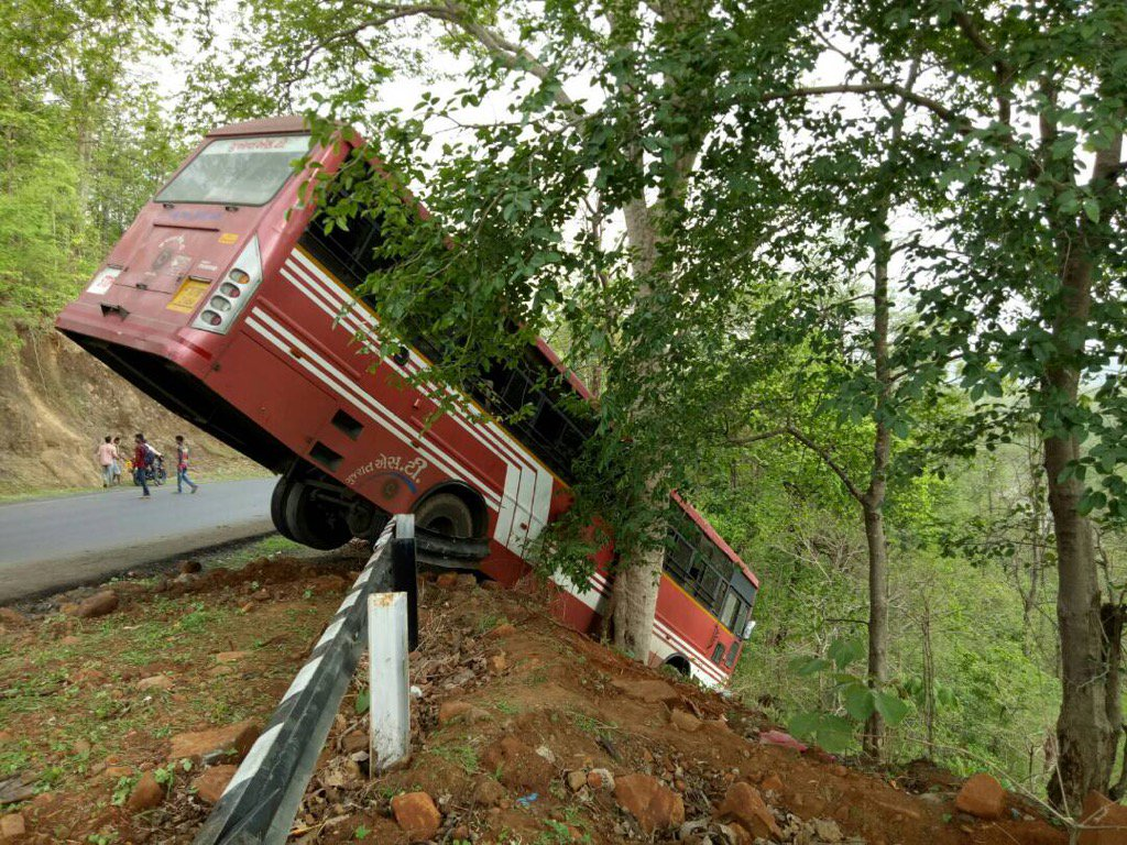 Miraculous escape for passengers as  bus hangs on valley in Dang