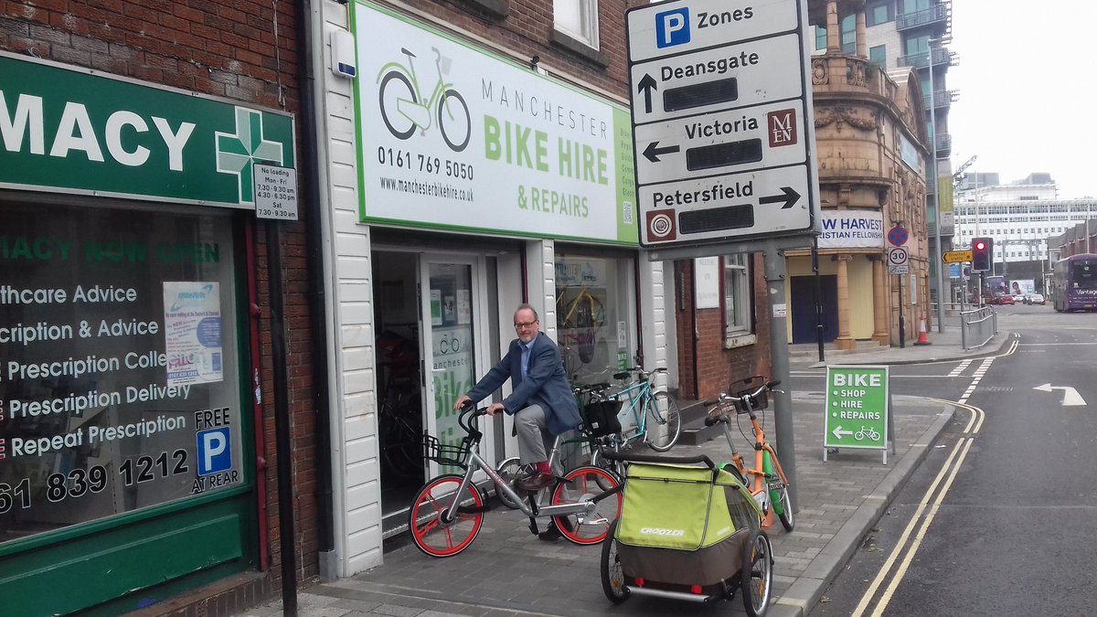 Richard #Mobiking outside our shop on #Mobike4MCR #McrPublicBikeScheme #excited #Sustainability #livingCity #CleanerAir @MobikeUk<br>http://pic.twitter.com/bRYODFUy3y