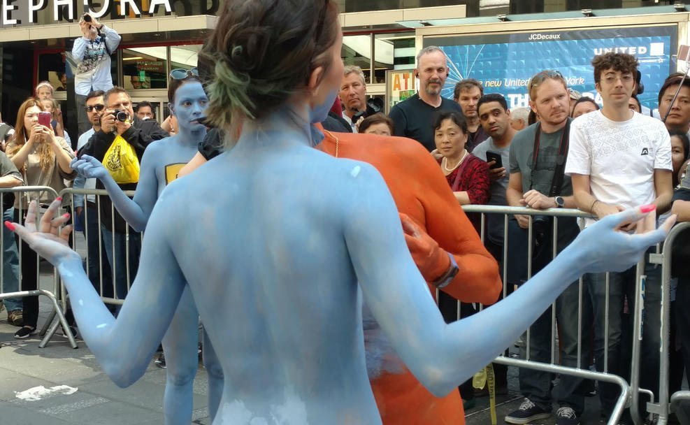 Naked models take over Times Square and pose for photos