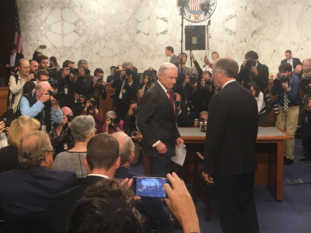 Sessions enter stage left.