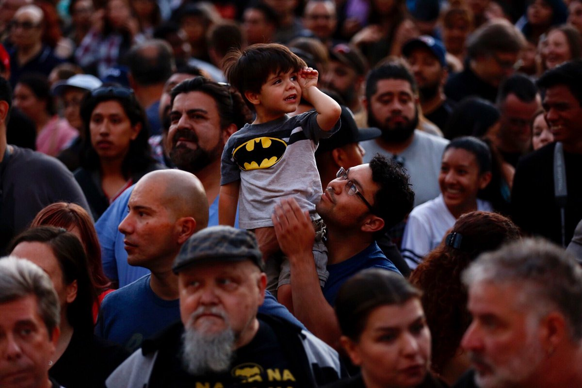 Artemio Rangel, 34, and son Roan wait for the Bat signal during a tribute to Adam West at L.A. City Hall on June 15. (Francine Orr / Los Angeles Times)