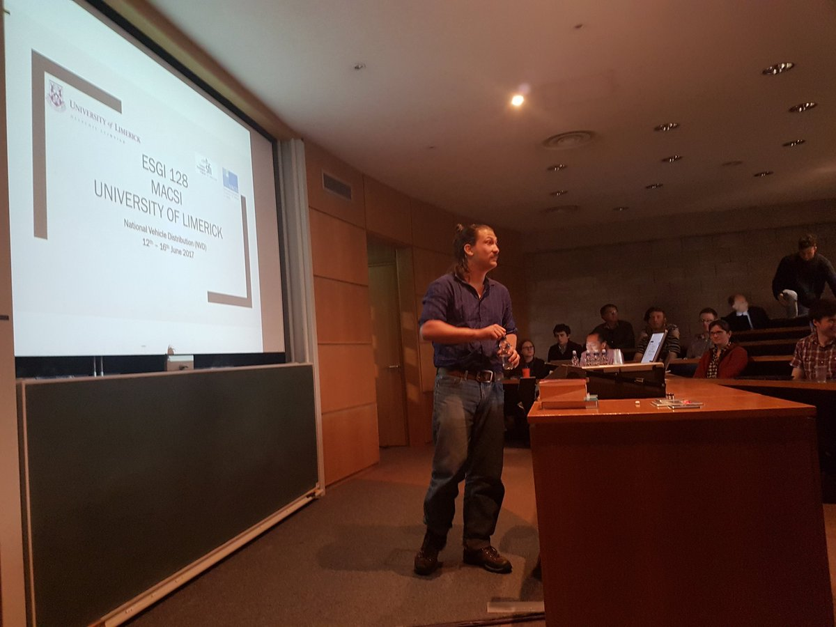 MACSI researcher Josh presenting the solution to a problem involving costing the lead time for company NVD who transport vehicles #esgi128 <br>http://pic.twitter.com/gw6oKE2R80