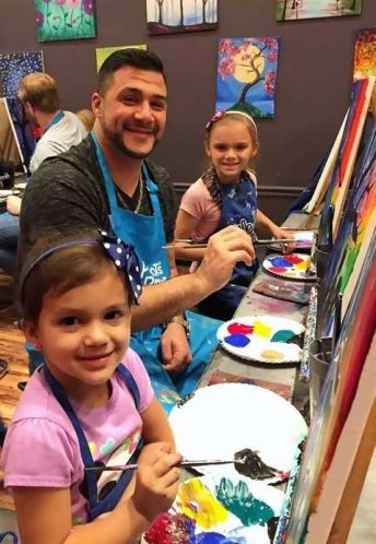 Daddy Daughter Date Night blooms into a group activity for these fathers
