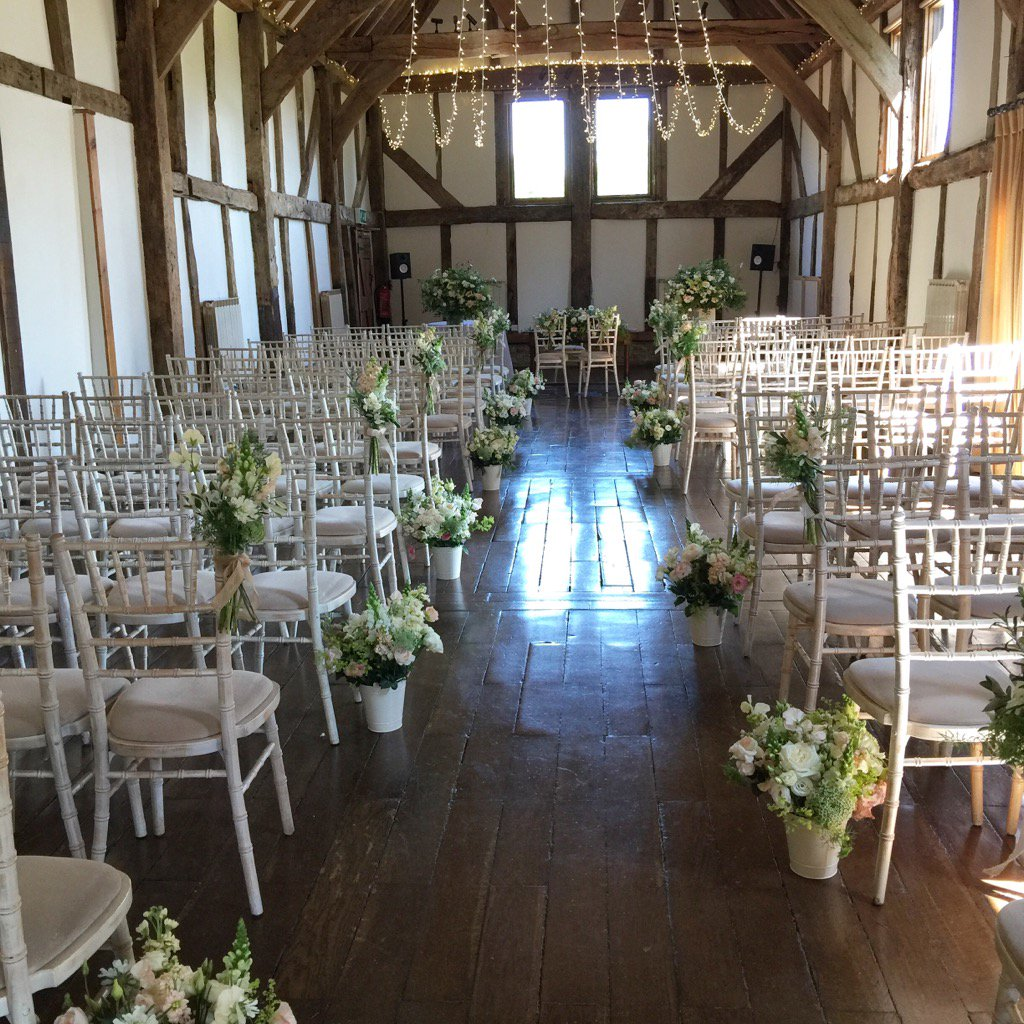 Beautiful #flowers from @edenblooms line the aisle for our gorgeous #wedding #ceremony in the barn @Loseleyevents