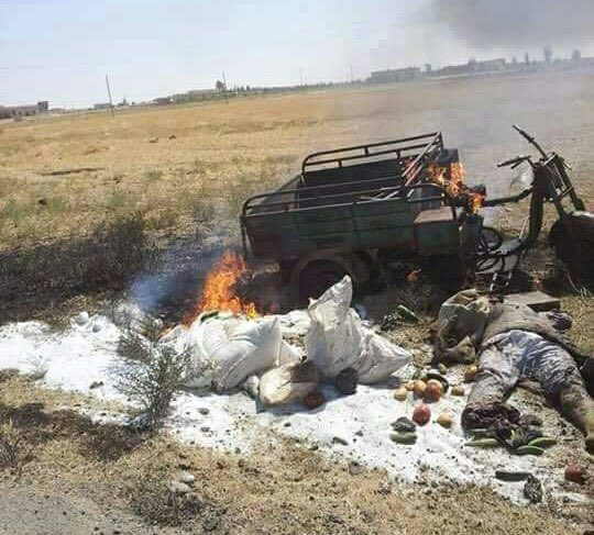 Is that really what #US spend millions to attack? Pic for vegetables seller near #Raqqa burned by airstrike of the #INTcollation #Terrorism<br>http://pic.twitter.com/K6HKiRMpjs