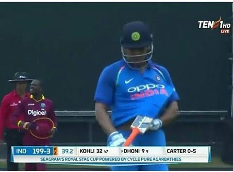 Rain Rain go away  MS Dhoni is trying to protect his bat from rain @msdhoni #MSDhoni #Dhoni #WIvIND #INDvsWI #IndvWI #TeamIndia #BleedBlue<br>http://pic.twitter.com/BjRsqSqDzE