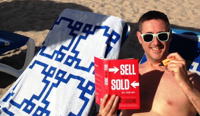 Reading #GrantCardone on the beach in #Javea, Spain. #SellOrBeSold<br>http://pic.twitter.com/SxnmCWrEfo