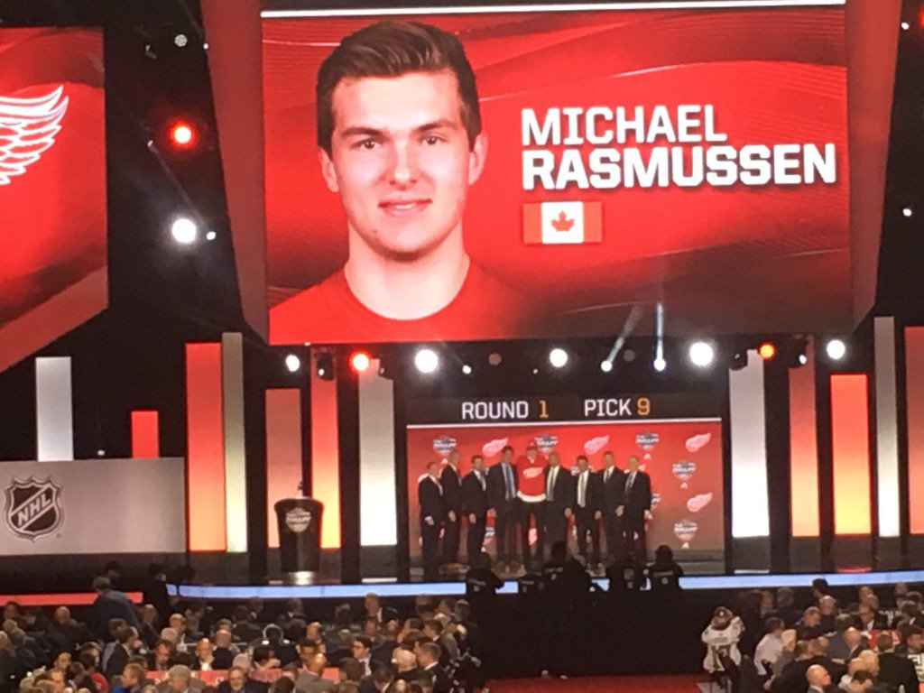 Michael Rasmussen towers over #RedWings front office members. #DRWDraf...