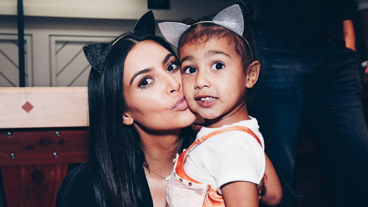 North West models Kim and Kanye's fur slides for kids: https://t.co/gU...