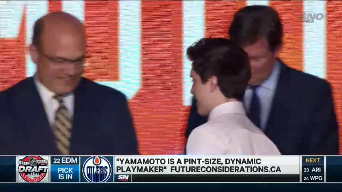 Kailer Yamamoto pulls on the Edmonton Oilers sweater for the first tim...