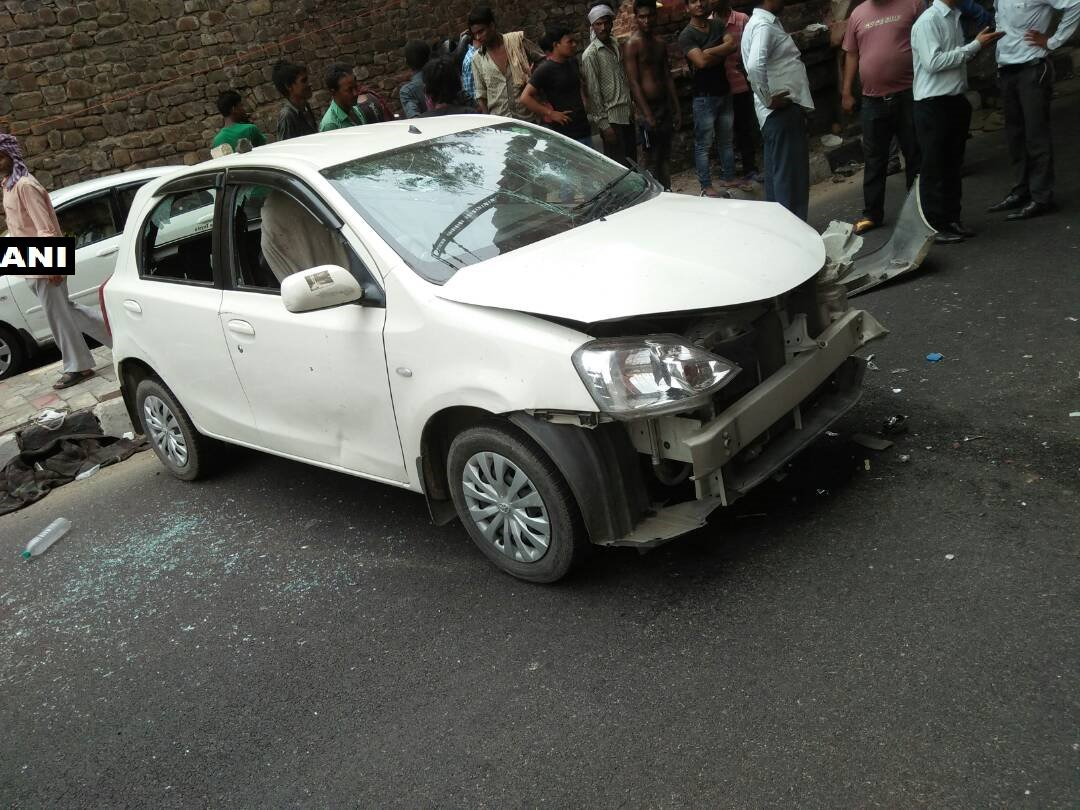 Car runs over four people sitting on the pavement near Delhi's Kashmere Gate, two dead and two injured. Driver arrested