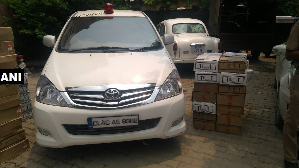 Delhi: Three people arrested in Nand Nagri on charges of smuggling liquor and using a red beacon on their car (ANI)