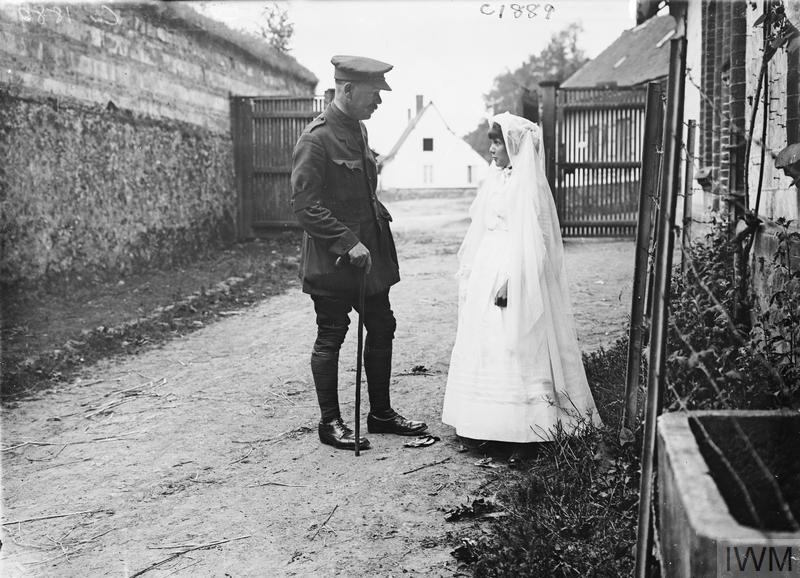 Jun 19, 1917 - British officer talking to a French girl on her way to her First Communion in Rollencourt, France #100yearsago