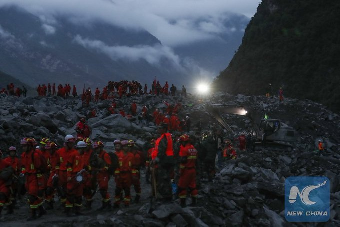 Rescue is underway overnight! 15 people have been confirmed dead in landslide that buried over 120 in SW China's Sichuan
