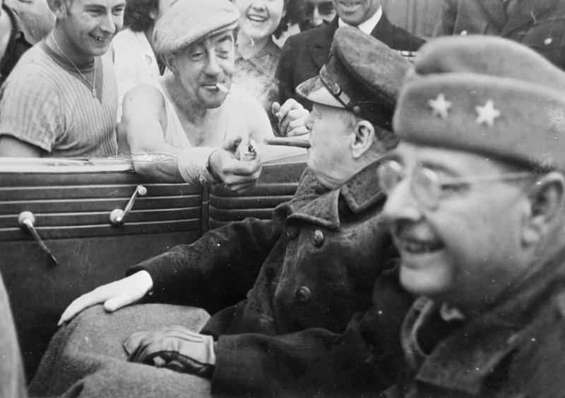 A French dock worker lighting Winston Churchill's cigar, 1944. https:/...