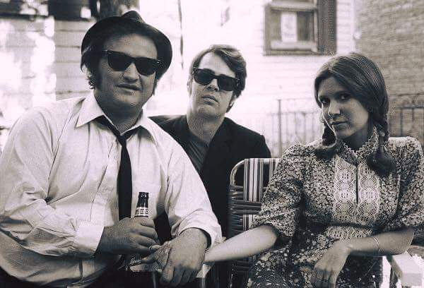 John Belushi, Dan Aykroyd, and Carrie Fisher share a moment on the set...