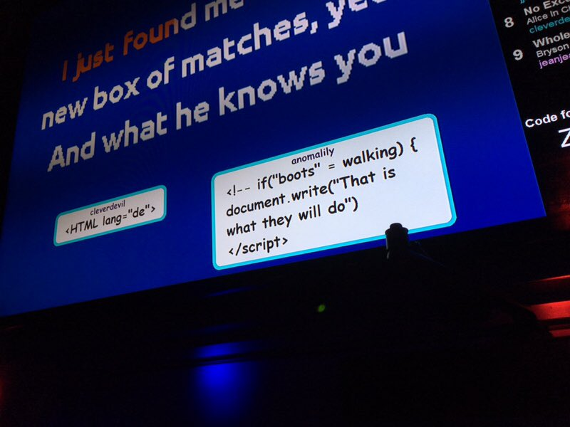 Photo of a karaoke screen with popups from indieweb participants with code inside