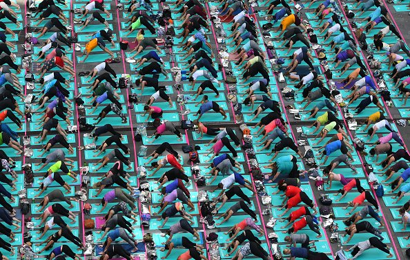 Yoga... 🙆🙋🙇♀️  How did it conquer the world and what's changed?  More: https://t.co/O7Qb0N8baS