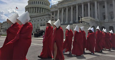 These activists channeled 'The Handmaid's Tale' to protest the #Trumpcare bill: https://t.co/BiKUxfbGcG