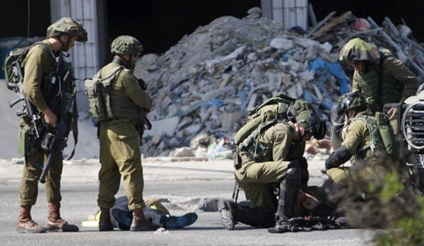 Again IOF#Israel# occupation #forces kill 22-years old boy claiming that he was disturbing their job in #west bank<br>http://pic.twitter.com/rQxHEAtaHZ