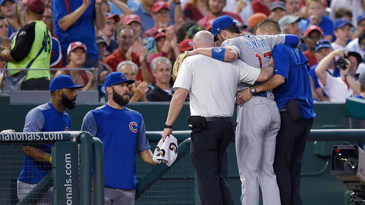 #Cubs' Kris Bryant had to be helped off the field with an apparent ank...