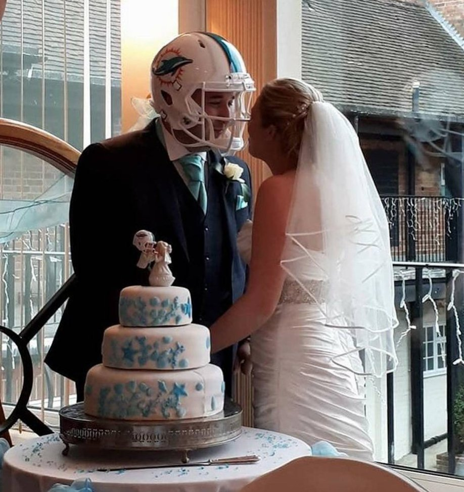 Matching with the wedding cake topper! 😂   Dolphins fan wears helmet a...
