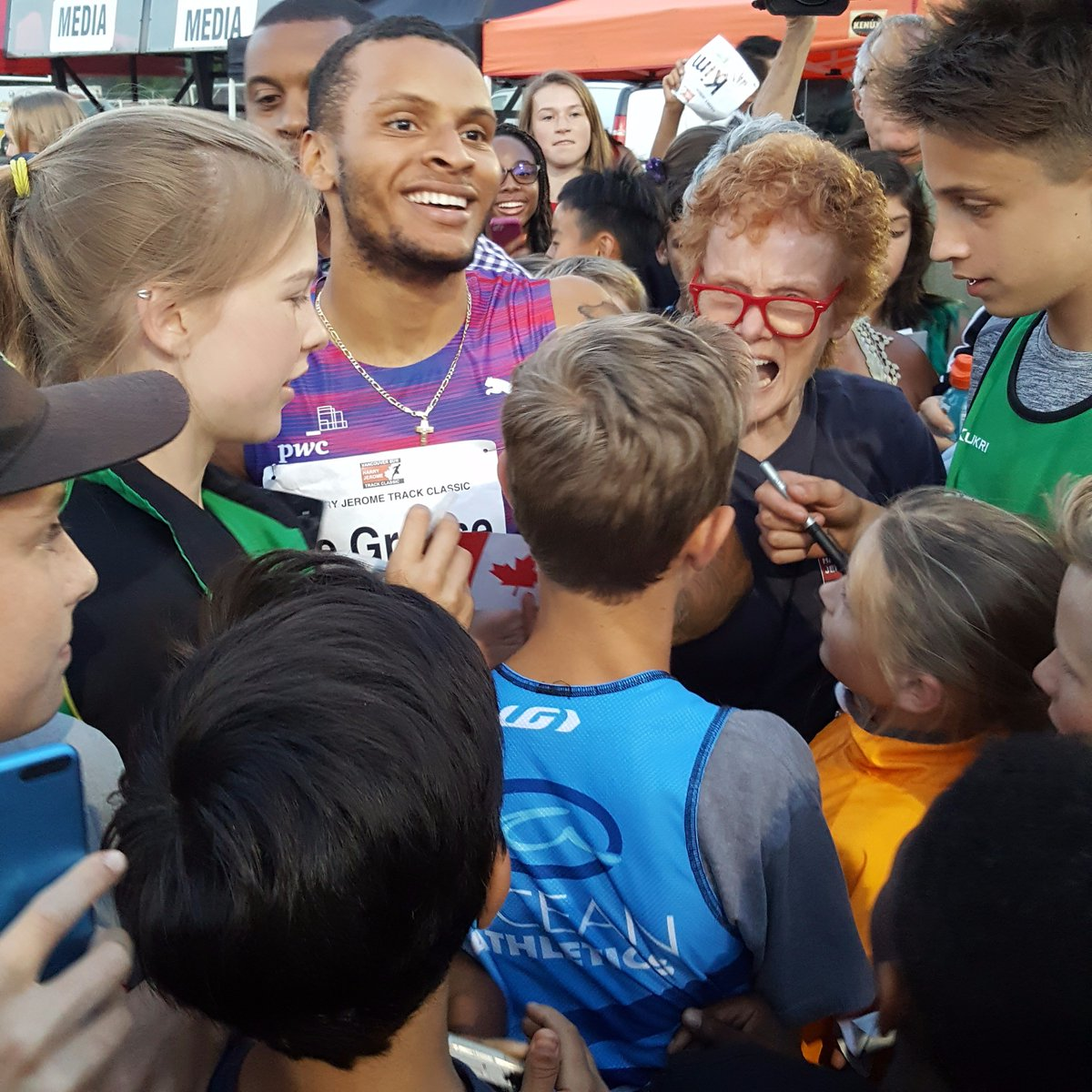 mobbed by children. Andre De Grasse - @De6rasse - after a leisurely 10...