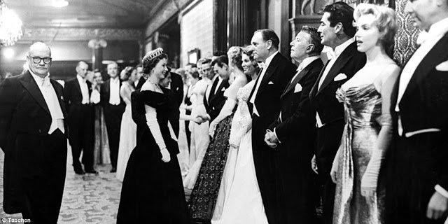 Pictures of Marilyn Monroe Meeting Queen Elizabeth II in London, 1956...