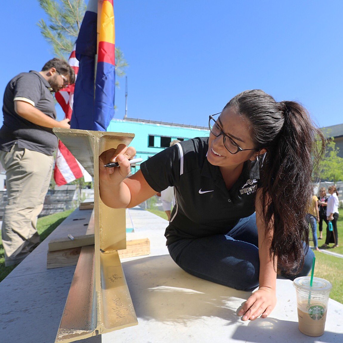 .@CUDenver student Jessica Rangel signs her name on the final steel beam of the CU Denver Wellness Center. #CUintheCity @DowntownDenver https://t.co/1k4XT4oYdL