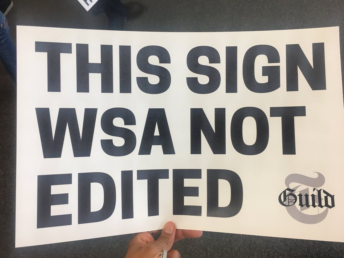 The sign NYT reporters are carrying to protest the coming wave of copy editor layoffs ✊