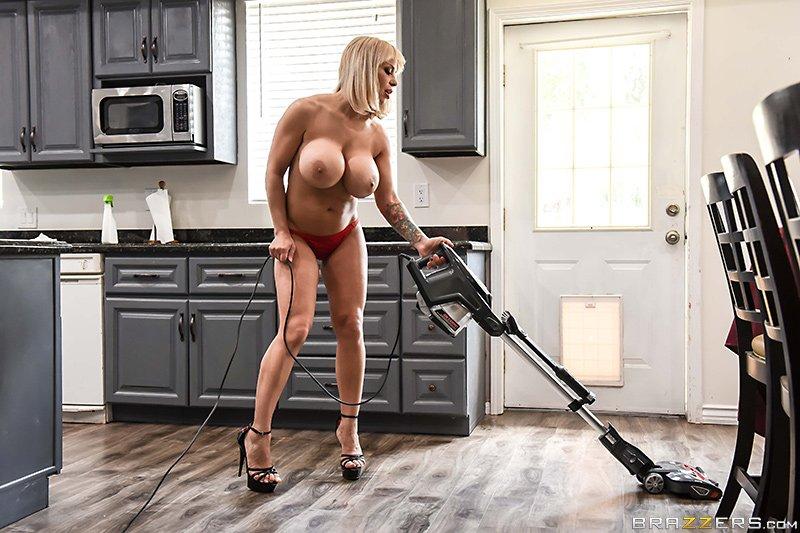 Busty milf cleaning floor